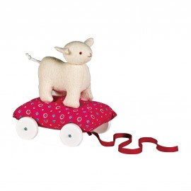 Mouton Ecru sur coussin à roulettes Fushia par Trousselier